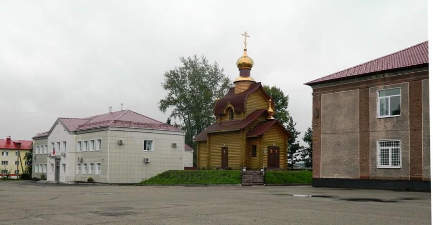 Кемеровская область, Яшкинский район, Яшкино. Церковь Казанской иконы Божией Матери, фотография. общий вид в ландшафте